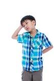 Muchacho de 7 años atractivo que hace la expresión de pensamiento O aislado Fotos de archivo libres de regalías