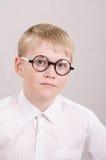 Muchacho de doce años con los vidrios Imagen de archivo