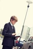 Muchacho de escuela con la tablilla electrónica Fotos de archivo libres de regalías
