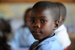 Muchacho de escuela en clase Imagen de archivo
