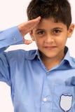 Muchacho de escuela que saluda Imagen de archivo libre de regalías