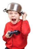 Muchacho de grito con el gamepad en manos Imagenes de archivo