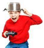 Muchacho de grito con el gamepad en manos Imagen de archivo