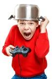 Muchacho de grito con el gamepad en manos Fotografía de archivo