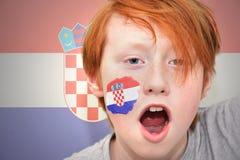 Muchacho de la fan del pelirrojo con la bandera croata pintada en su cara Imagen de archivo libre de regalías