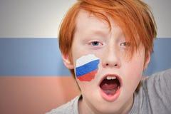 Muchacho de la fan del pelirrojo con la bandera rusa pintada en su cara Fotografía de archivo libre de regalías