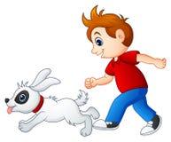 Muchacho de la historieta que juega con su animal doméstico ilustración del vector