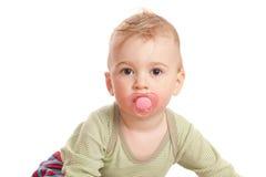 Muchacho de la inocencia con el maniquí de un bebé Foto de archivo libre de regalías