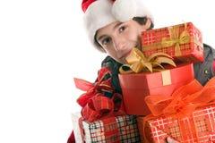 Muchacho de la Navidad con los regalos Fotografía de archivo