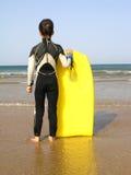 Muchacho de la persona que practica surf Foto de archivo