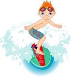 Muchacho de la persona que practica surf en la acción Imágenes de archivo libres de regalías