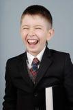 Muchacho de risa fotografía de archivo libre de regalías