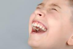 Muchacho de risa Foto de archivo libre de regalías