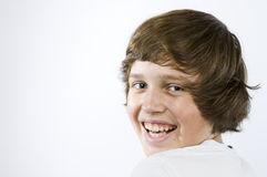 Muchacho de risa en blanco Fotografía de archivo libre de regalías