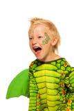 Muchacho de rugido en traje del dragón del monstruo Fotos de archivo libres de regalías