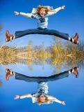 Muchacho de salto feliz imagen de archivo libre de regalías