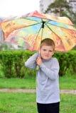 Muchacho de seis años en un paseo Imágenes de archivo libres de regalías