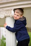 Muchacho de seis años en un paseo Fotos de archivo libres de regalías
