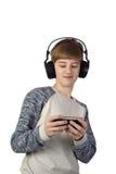 Muchacho de Teenege con el teléfono celular en el fondo blanco Imágenes de archivo libres de regalías