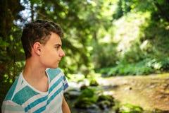 Muchacho del adolescente en el bosque Imagen de archivo libre de regalías