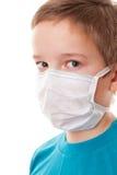 Muchacho del adolescente en máscara quirúrgica Imágenes de archivo libres de regalías