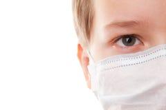 Muchacho del adolescente en máscara quirúrgica Imagen de archivo libre de regalías