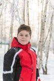 Muchacho del adolescente en parque del invierno Imágenes de archivo libres de regalías
