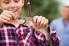 Muchacho del adolescente que mira pescados en el gancho Imágenes de archivo libres de regalías