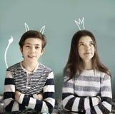 Muchacho del adolescente y demonio y princesa de la muchacha Foto de archivo