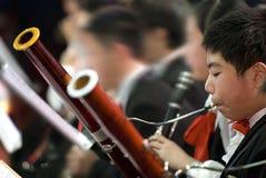 Muchacho del Bassoon Imágenes de archivo libres de regalías