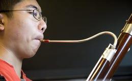 Muchacho del Bassoon Imagen de archivo