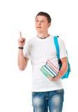 Muchacho del estudiante con libros y una mochila Foto de archivo