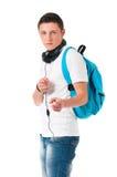 Muchacho del estudiante con los auriculares Imágenes de archivo libres de regalías