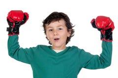 Muchacho del ganador con los guantes de boxeo Foto de archivo libre de regalías