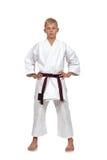 Muchacho del karate con la correa marrón Foto de archivo