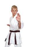 Muchacho del karate en kimono Fotografía de archivo