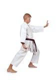 Muchacho del karate en la lucha blanca del kimono Imágenes de archivo libres de regalías