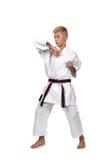 Muchacho del karate en la lucha del kimono Imagenes de archivo