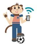 Muchacho del mono con el teléfono móvil Imagen de archivo