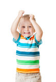 Muchacho del niño con las manos para arriba aisladas en blanco Imagenes de archivo