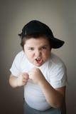 Muchacho del niño de la agresión del boxeo de la lucha del niño Imágenes de archivo libres de regalías