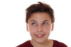 Muchacho del niño del adolescente que sonríe y que mira para arriba Fotografía de archivo libre de regalías
