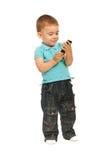 Muchacho del niño que sostiene un teléfono celular Foto de archivo libre de regalías