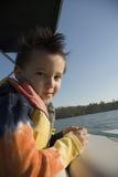 Muchacho del paseo del barco Fotos de archivo libres de regalías
