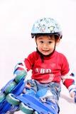Muchacho del patinaje de rodillo que hace caras Fotografía de archivo