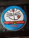 Muchacho del personaje de dibujos animados del doremon de la torta Fotos de archivo