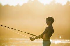 Muchacho del pescador con el giro Fotos de archivo