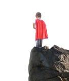 Muchacho del superhéroe listo para volar en el fondo blanco Imagenes de archivo