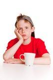 Muchacho deprimido con la taza blanca Fotos de archivo libres de regalías