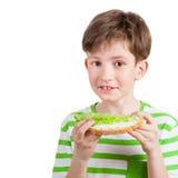 Muchacho divertido con el bocadillo de la dieta Fotografía de archivo libre de regalías